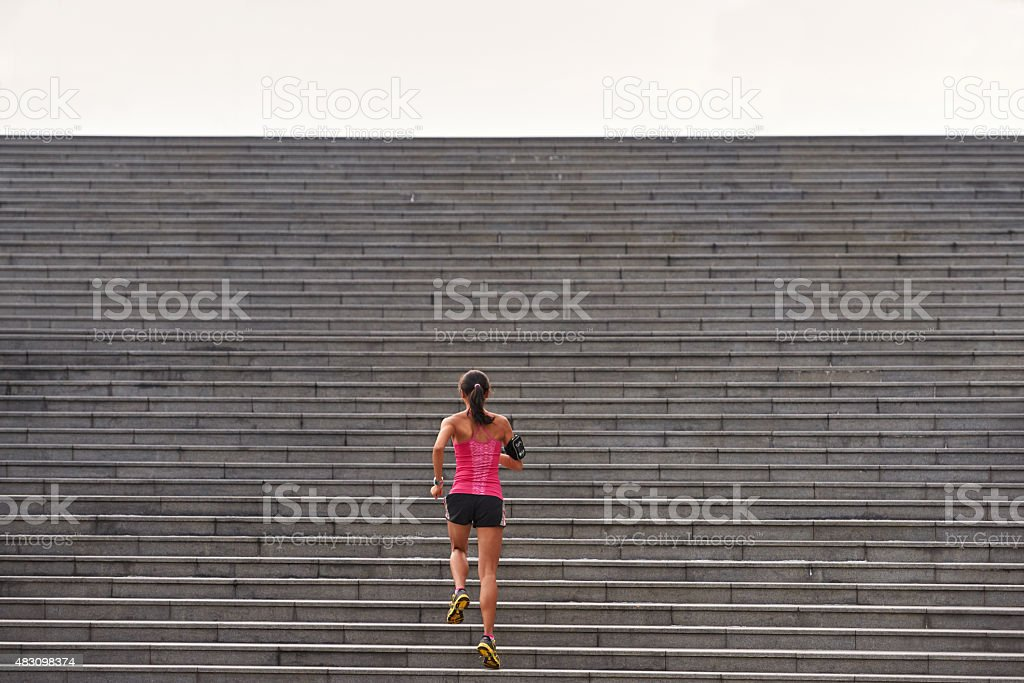 fitness woman running steps stock photo