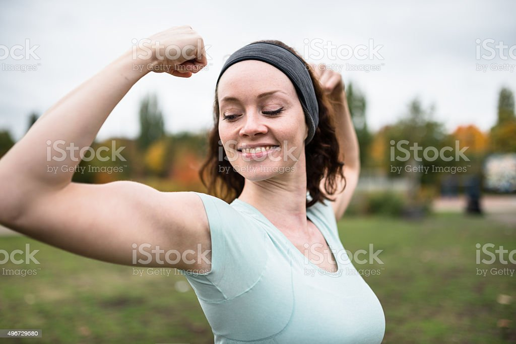 Fitness woman showing the muscle stock photo