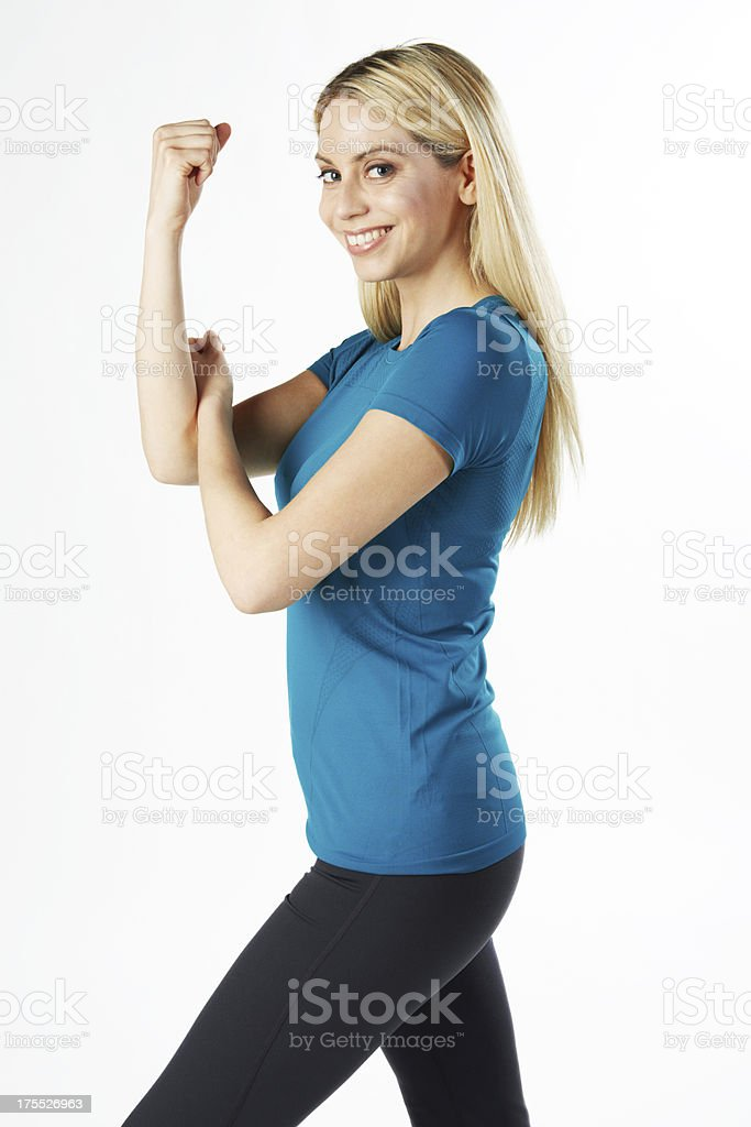 Fitness woman smiling flexing biceps royalty-free stock photo
