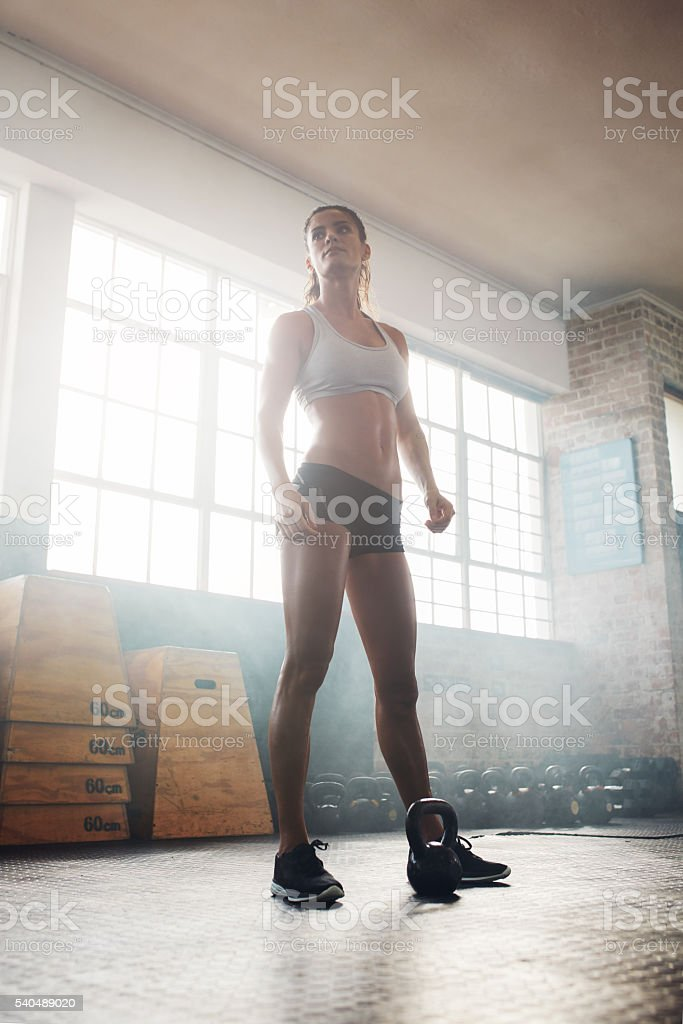 Fitness woman standing in gym stock photo