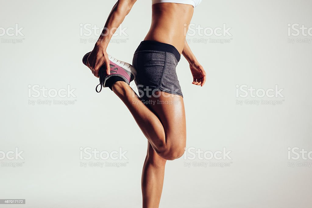 Fitness woman stretching her legs stock photo