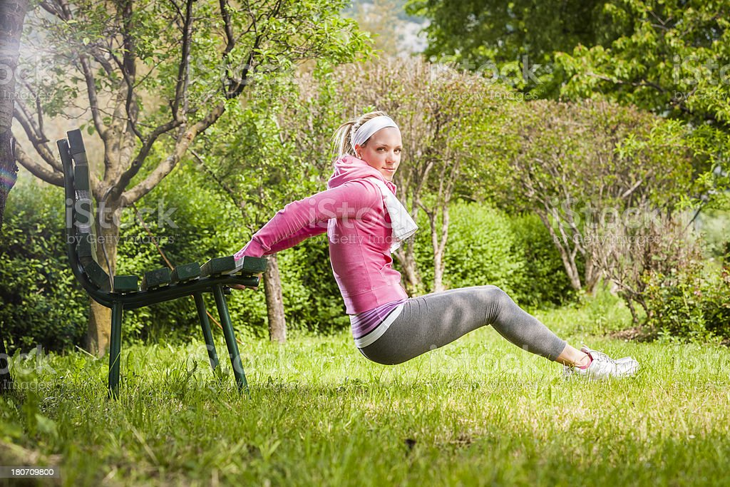 Fitness Woman. Stretching in a park royalty-free stock photo
