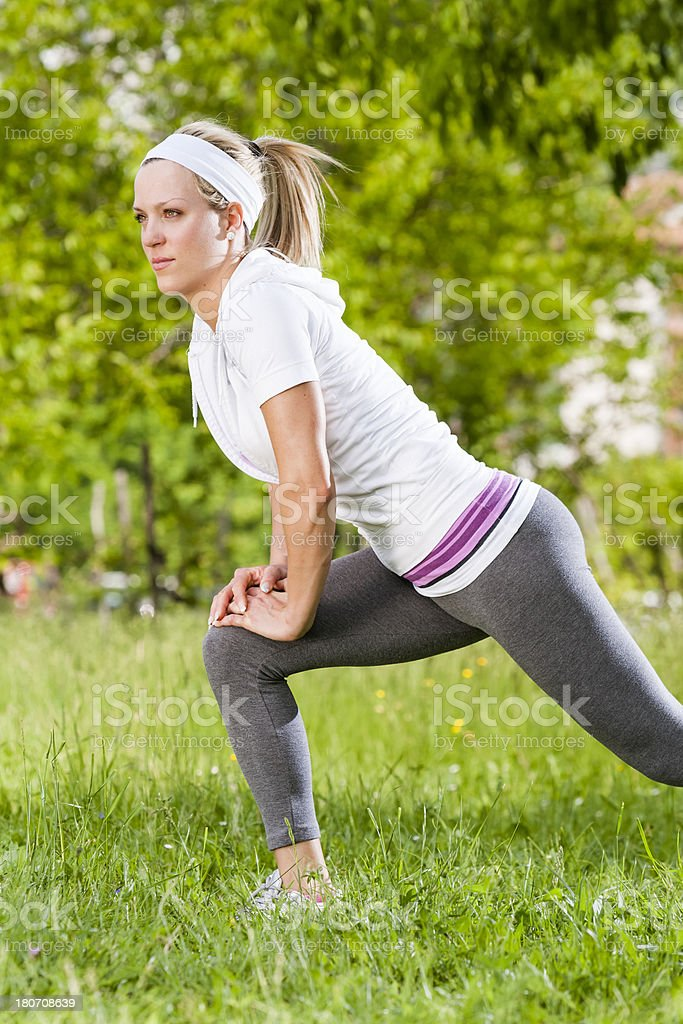 Fitness Woman. Stretching outdoor royalty-free stock photo