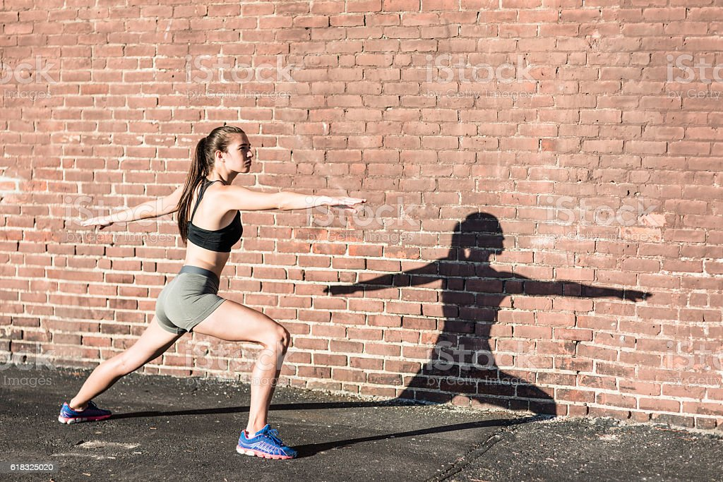 fitness woman stretching the calf on the wall stock photo