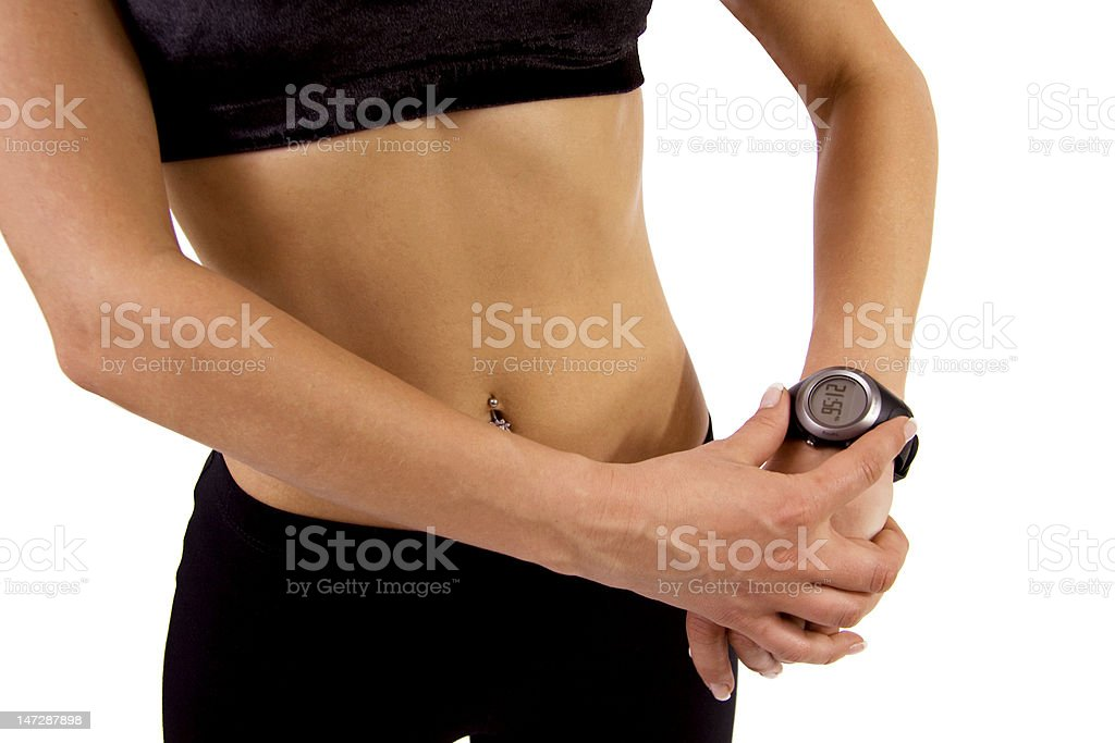 Fitness woman with a GPS watch royalty-free stock photo