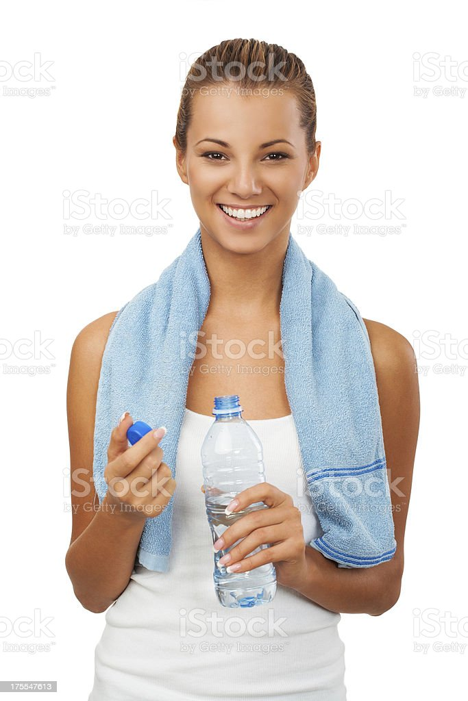 Fitness woman with bottle and towel royalty-free stock photo