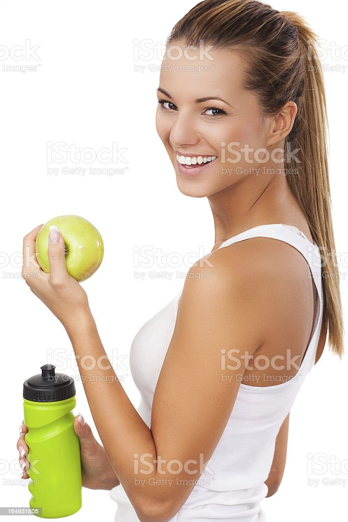 Fitness women with bottle and apple royalty-free stock photo
