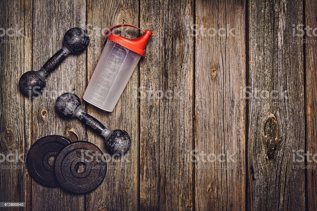 Fitness workout background. Dumbbells on wooden floor stock photo
