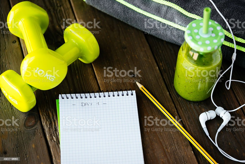Fitness workout routine blank notebook and detox smoothie stock photo