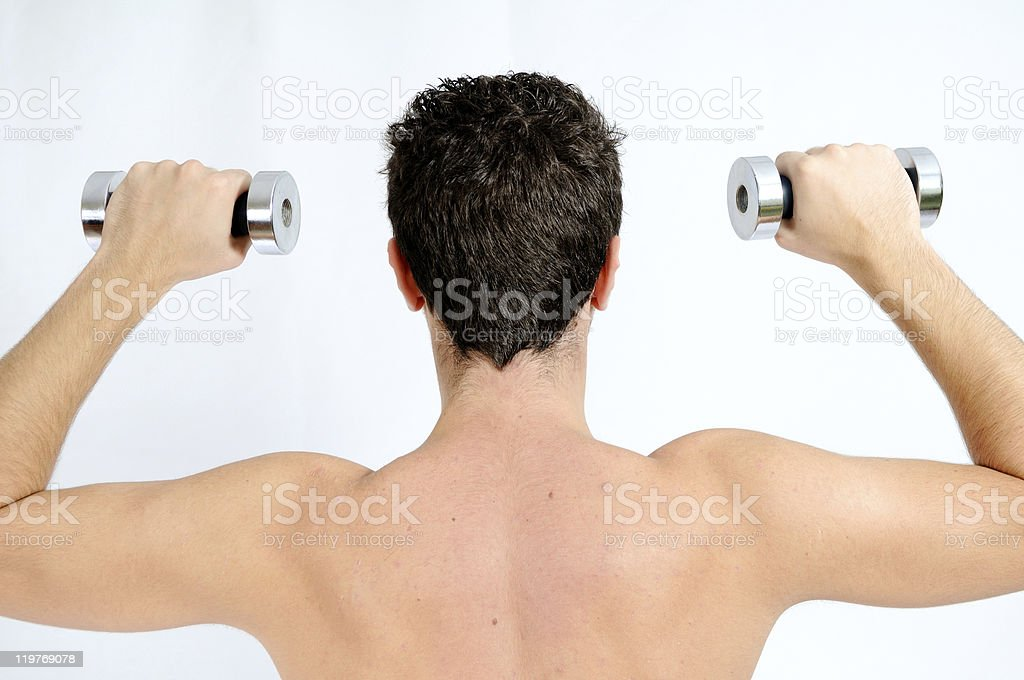 Fitness, Young man back lifting weights stock photo