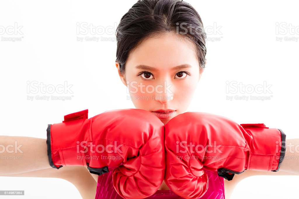 fitness young woman  wearing red boxing gloves stock photo
