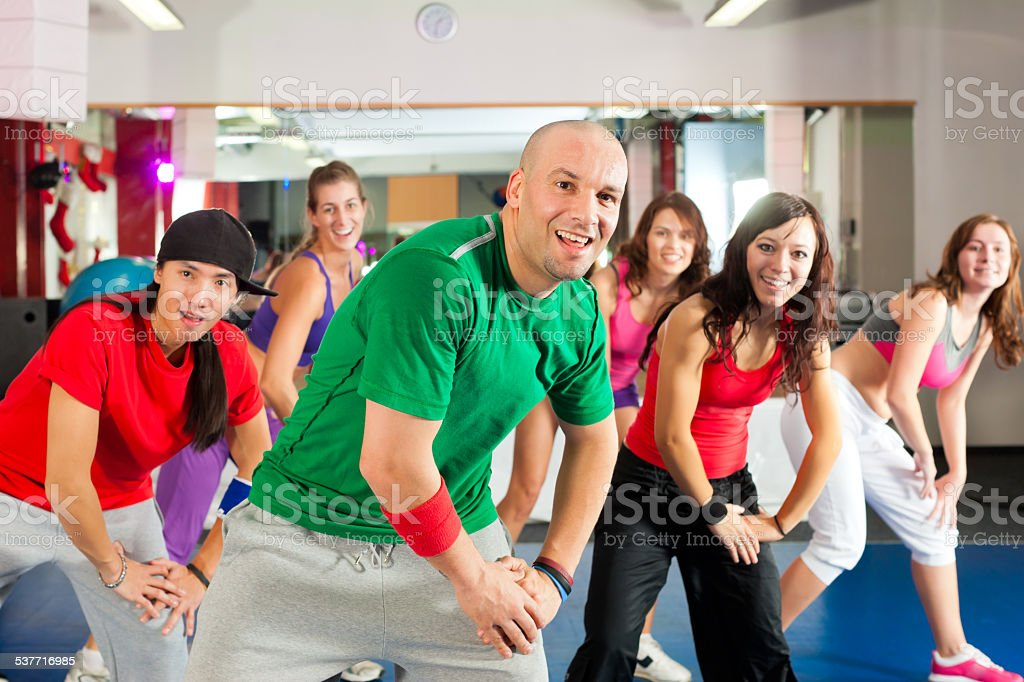 Fitness - Zumba dance workout in gym stock photo