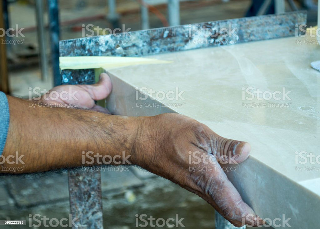 Fitting of marble nosing onto countertop stock photo