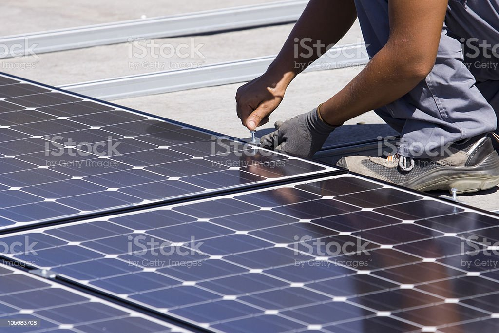 fitting photovoltaic panels royalty-free stock photo
