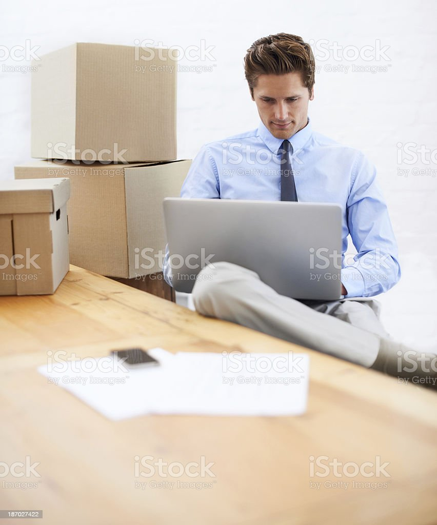 Fitting some work in while moving offices royalty-free stock photo