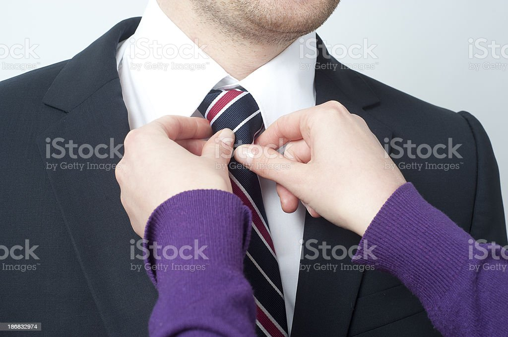 fitting the tie royalty-free stock photo