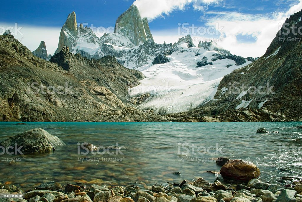 Fitz roy peaks with clear blue glacial lake, low perspective stock photo