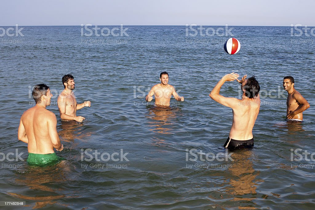 five adult men with ball in water royalty-free stock photo