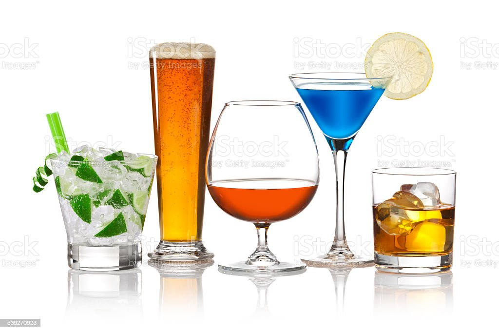 Five alcoholic drinks on reflective white background stock photo