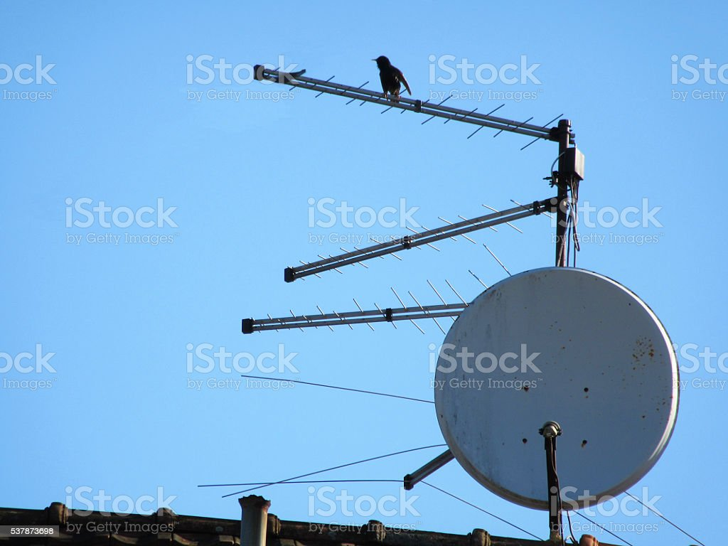 five antenna system on the roof under the blue sky stock photo