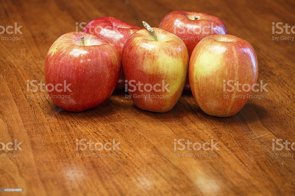 Five Apples on Wood Table with Space in Front royalty-free stock photo