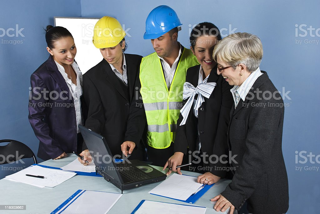 Five architects team in office working royalty-free stock photo
