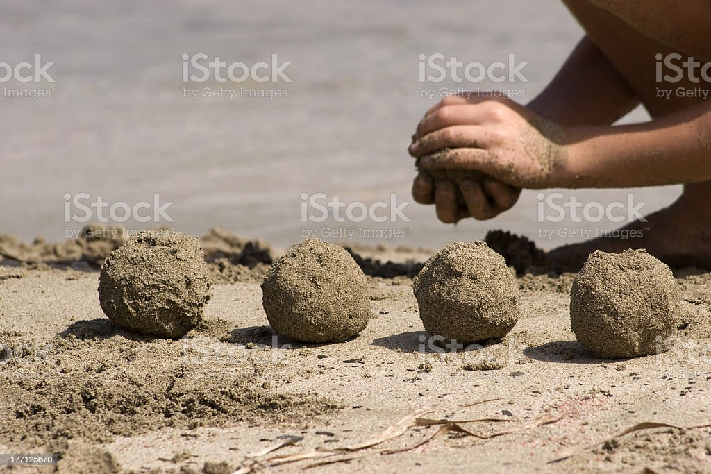Five balls of sand stock photo