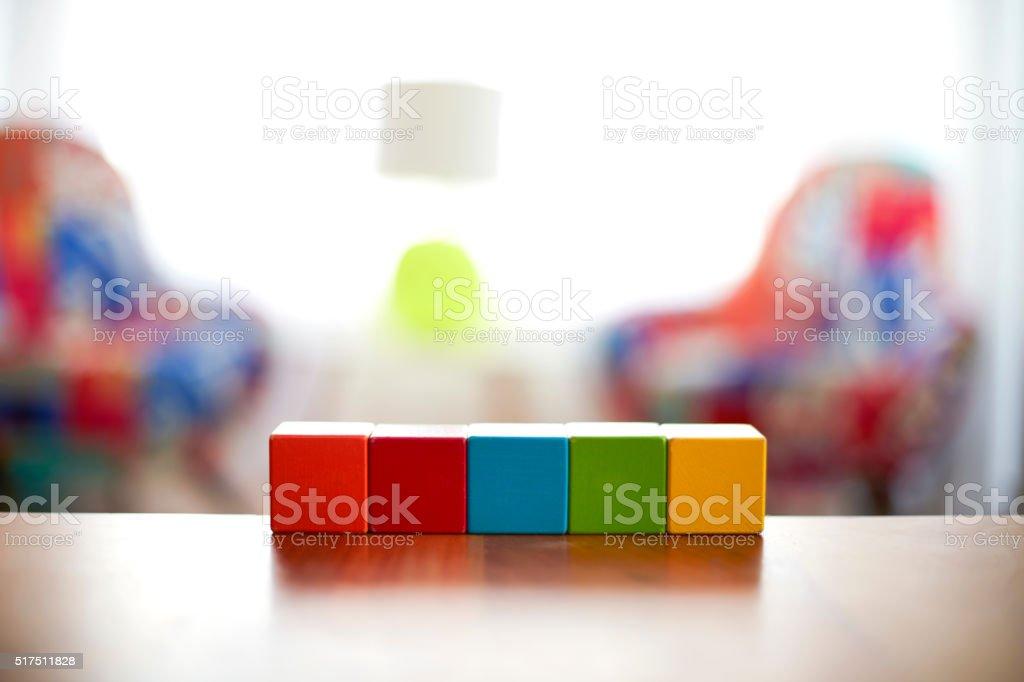 Five Blank colourful building blocks stock photo