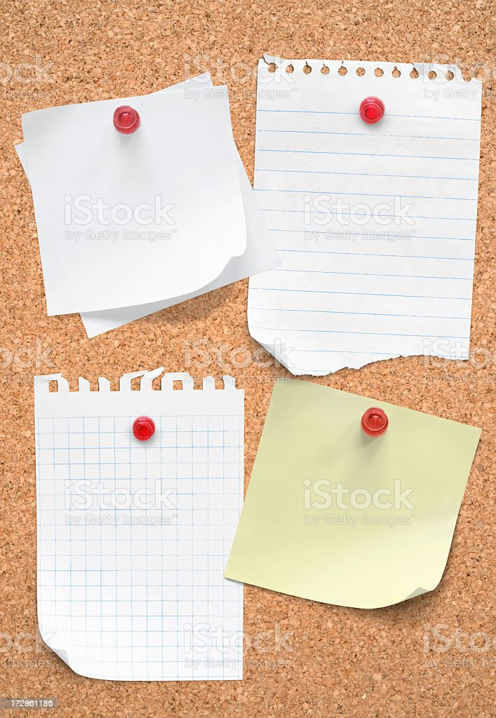 Five blank pieces of paper tacked to cork board royalty-free stock photo