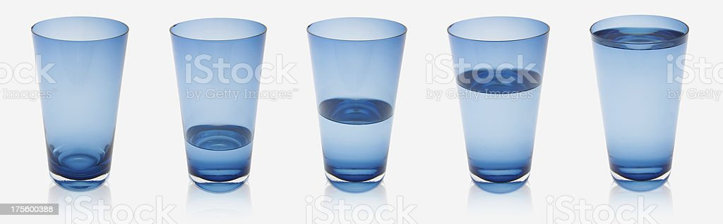 Five blue glasses with different water levels *Clipping path included* royalty-free stock photo
