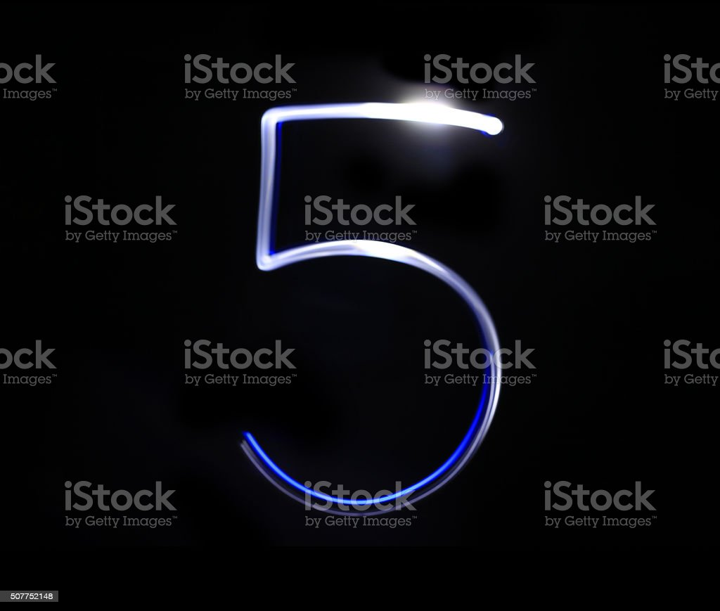 Five blue light digit hand writing over black background. stock photo
