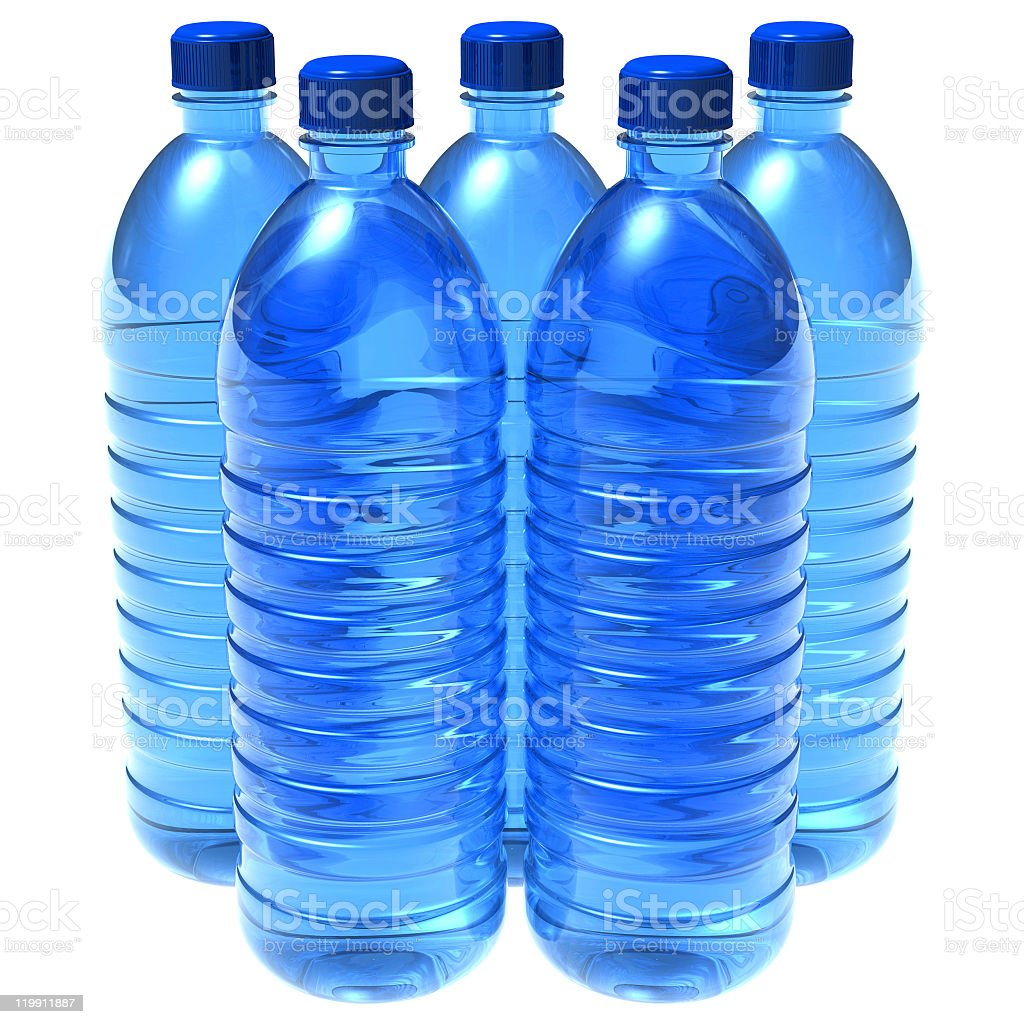 Five bottles of water with blue lids on a white table royalty-free stock photo