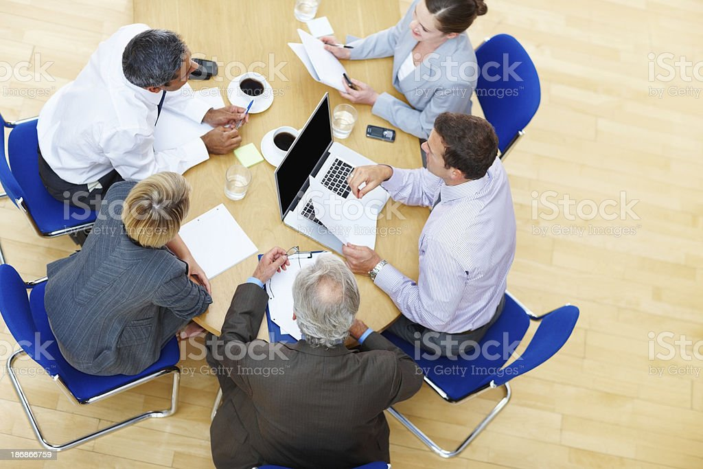 Five business people in a meeting royalty-free stock photo