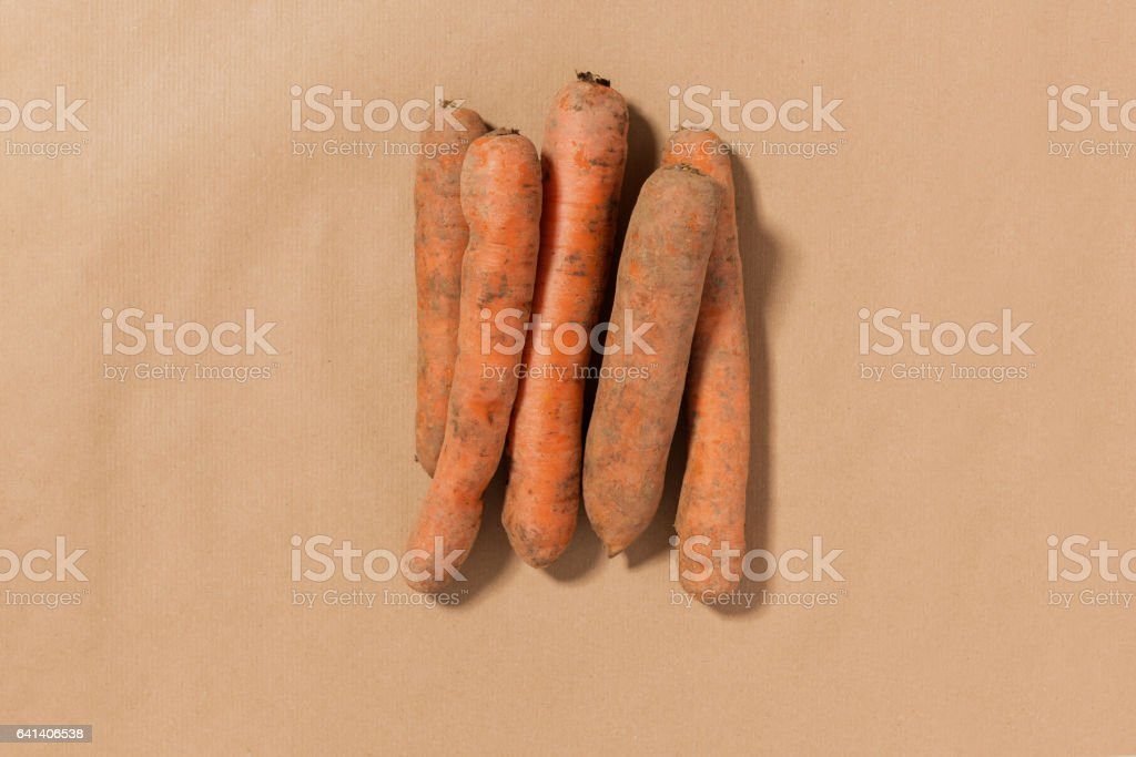 Five Carrots on a Tan Background stock photo