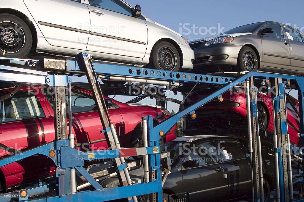 Five cars being transported on a truck stock photo