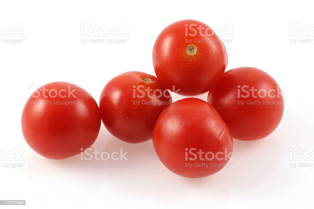 Five cherry tomatoes over a white background stock photo
