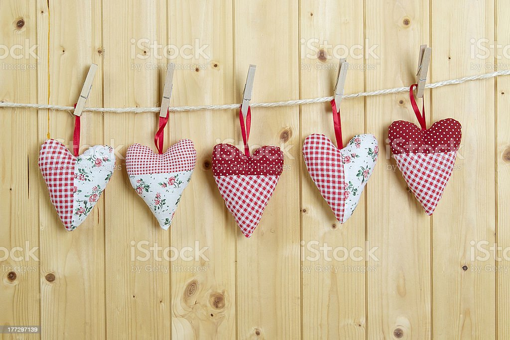 Five colored cotton hearts royalty-free stock photo