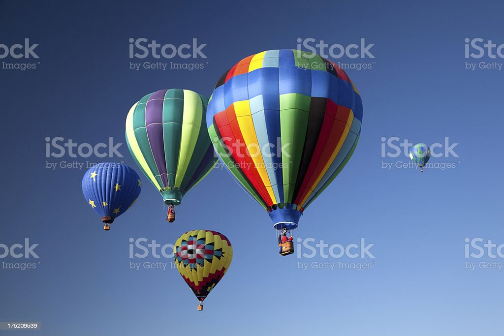Five colorful hot air balloons in the air with blue skies royalty-free stock photo
