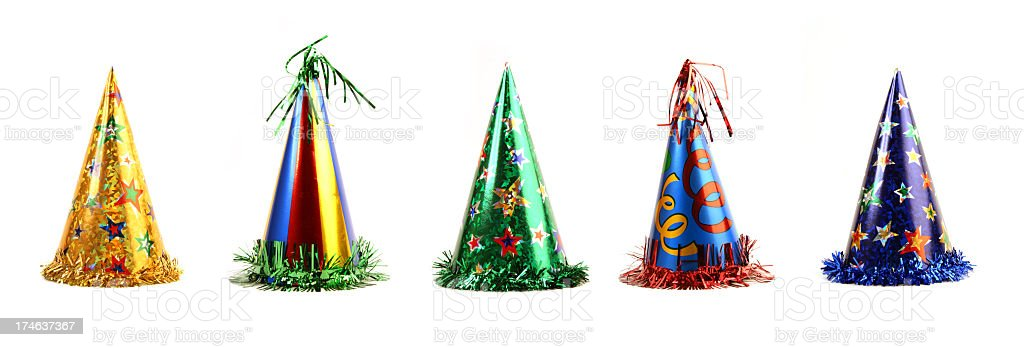 Five colorful party hats on a white background stock photo
