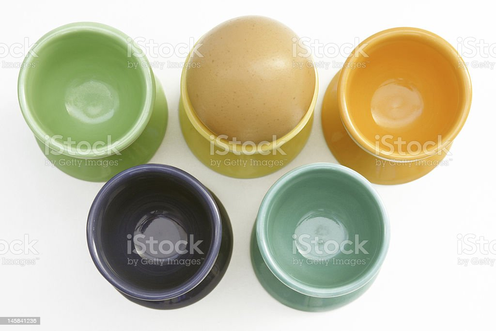 Five containters and one egg royalty-free stock photo