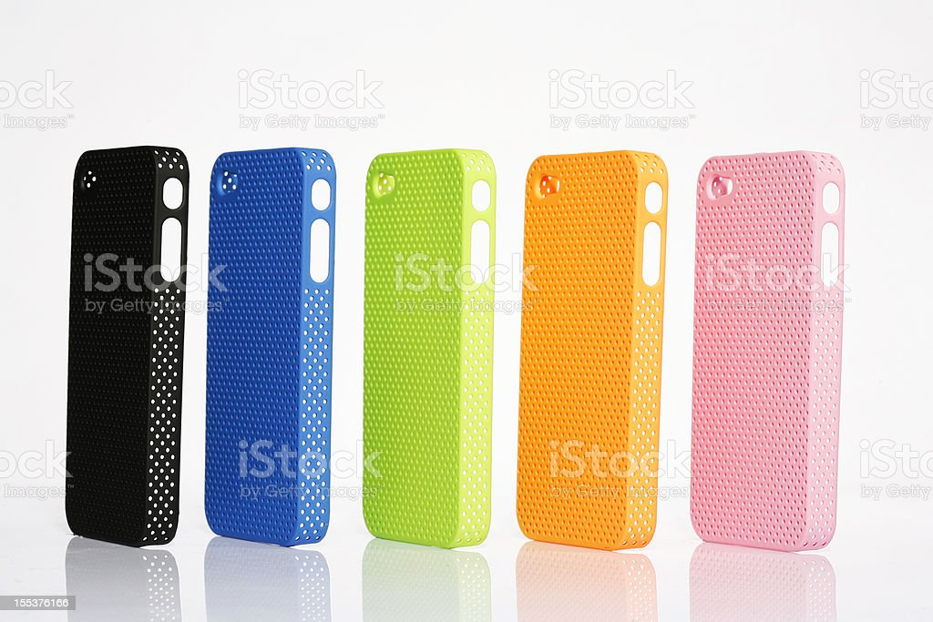 Five different colored cell phone protective cases stock photo