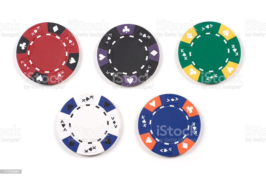 Five different colored poker chips stock photo