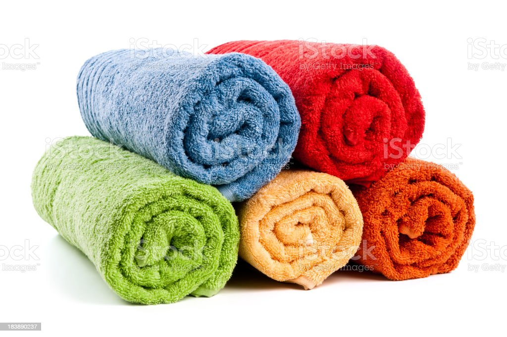 Five different colored rolled towels on white stock photo