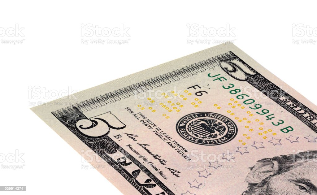 Five dollar bill on white background stock photo