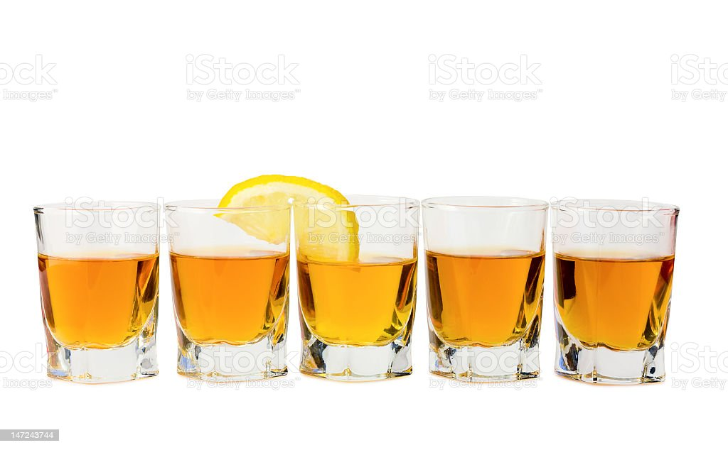 Five drinks in glass cups with one lemon slice stock photo