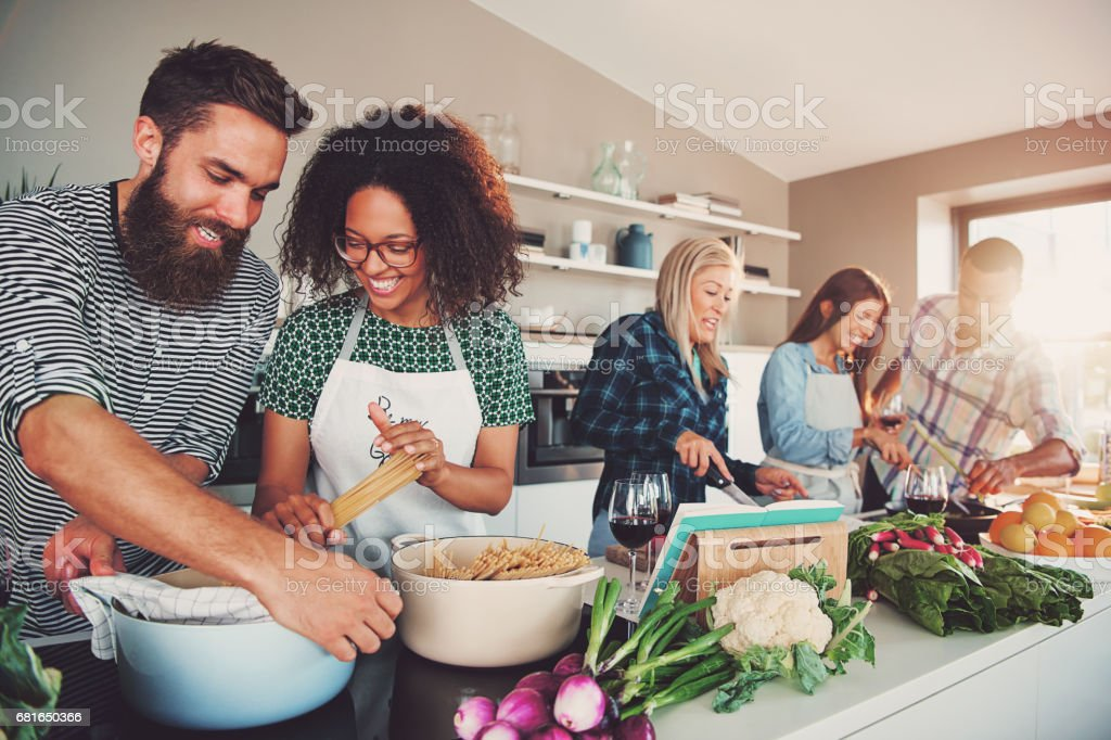 Five friends cooking stock photo