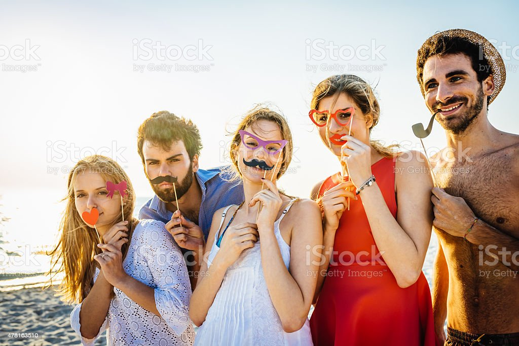 Five Friends Have A Party On The Beach stock photo