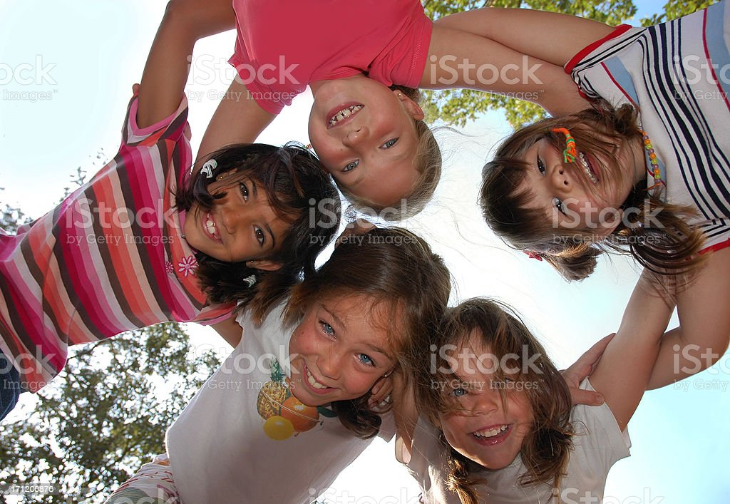 Five friends huddling stock photo