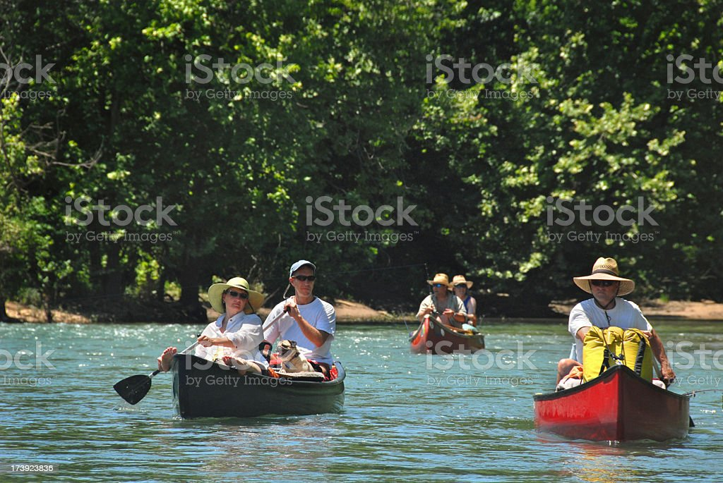 Five Friends in Canoes on a River stock photo