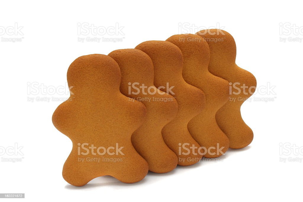five gingerbread men in a row  - concept sameness cloning royalty-free stock photo